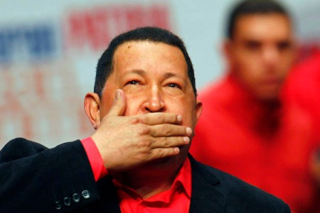 File photo of Venezuela's President Hugo Chavez blowing a kiss as he arrives at a rally with supporters in Caracas